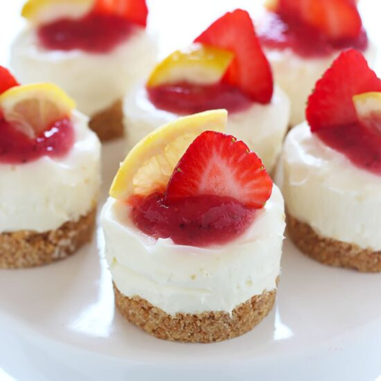 Fruity, tart, and ADORABLE, these No Bake Strawberry Lemonade Mini Cheesecakes are the perfect summer treat!