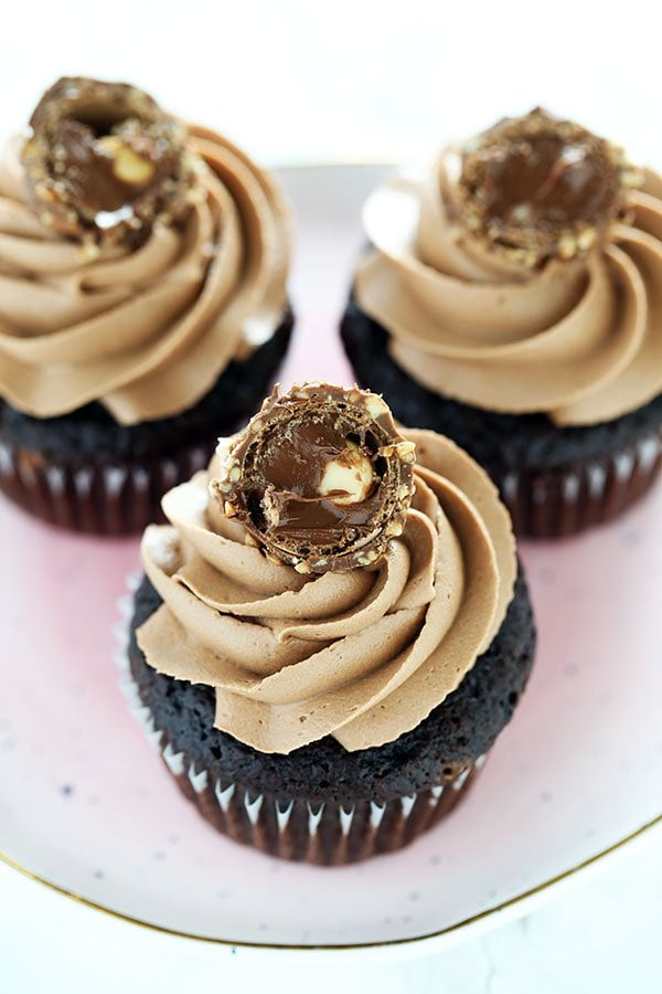 Ultimate Nutella Cupcakes feature my perfectly moist chocolate cupcake base which is filled with Nutella, topped with Nutella buttercream, and garnished with a Ferrero Rocher candy! It's Nutella perfection!