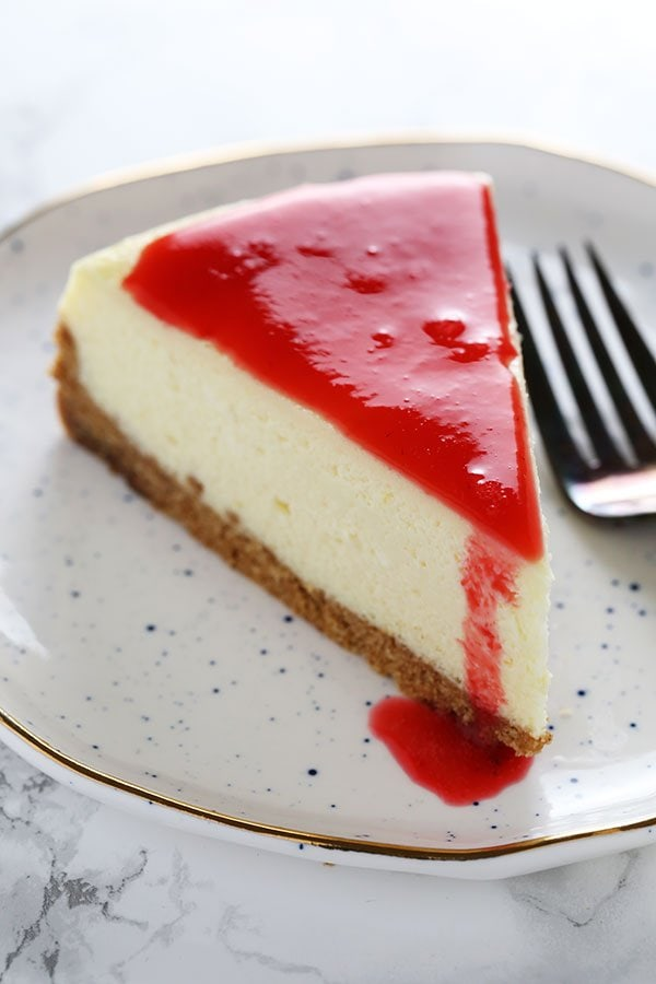 Stop right here! This is the ULTIMATE Cheesecake recipe! It took lots of testing to get a perfectly smooth and tangy cheesecake with NO CRACKS. This ones a keeper.