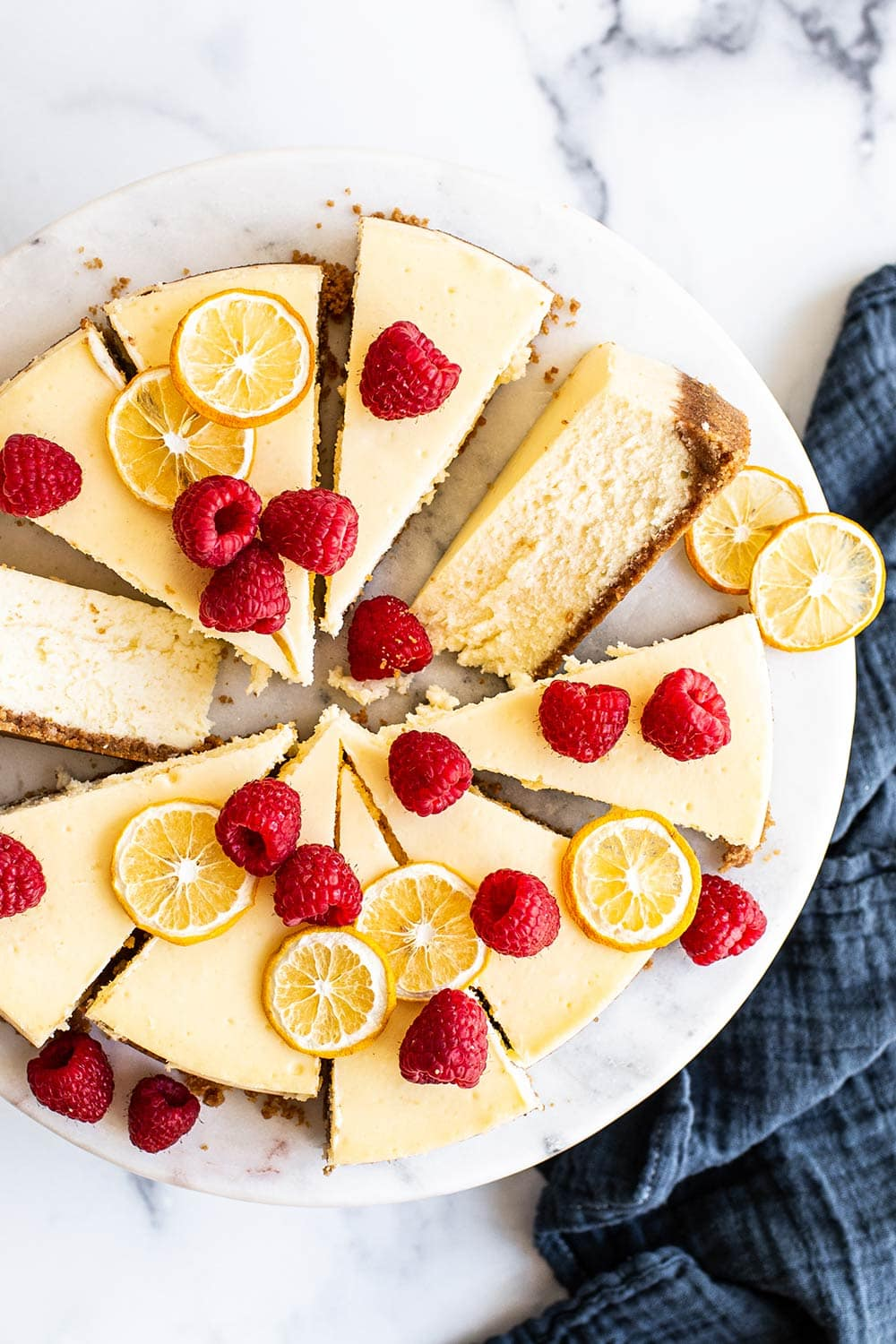 overhead shot with slices of classic baked cheesecake with fruit on top