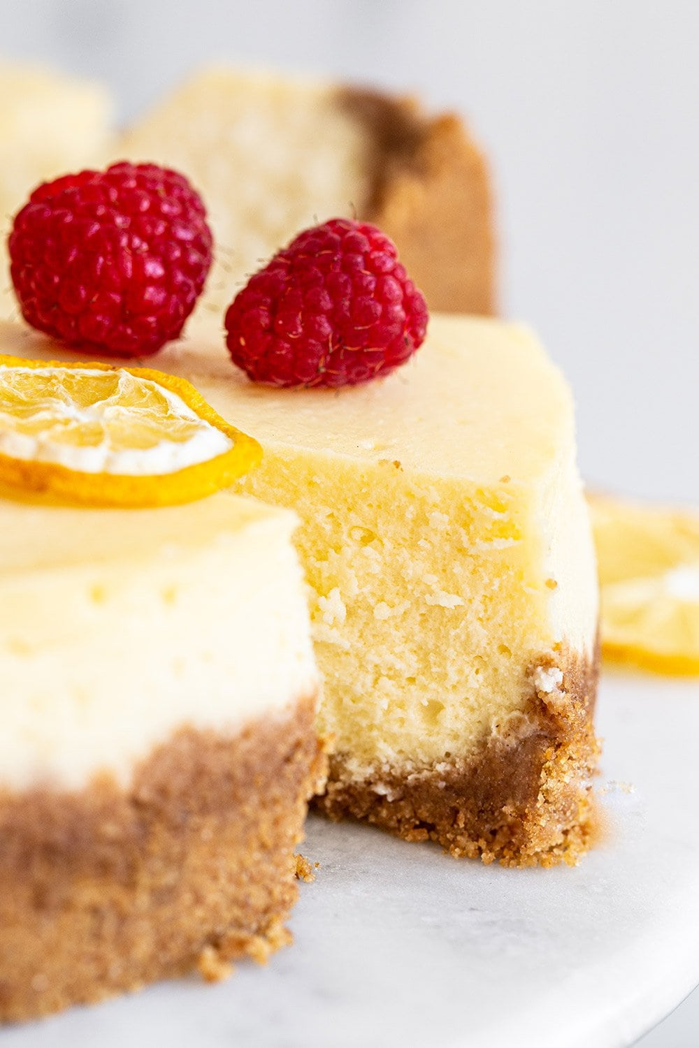 slice of rich classic cheesecake with fruit garnished on top