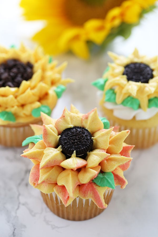 How to Make Sunflower Cupcakes with three different buttercream decorating methods that anyone can do! They're so fun, happy, and beautiful that everyone will think they came from an expensive bakery!