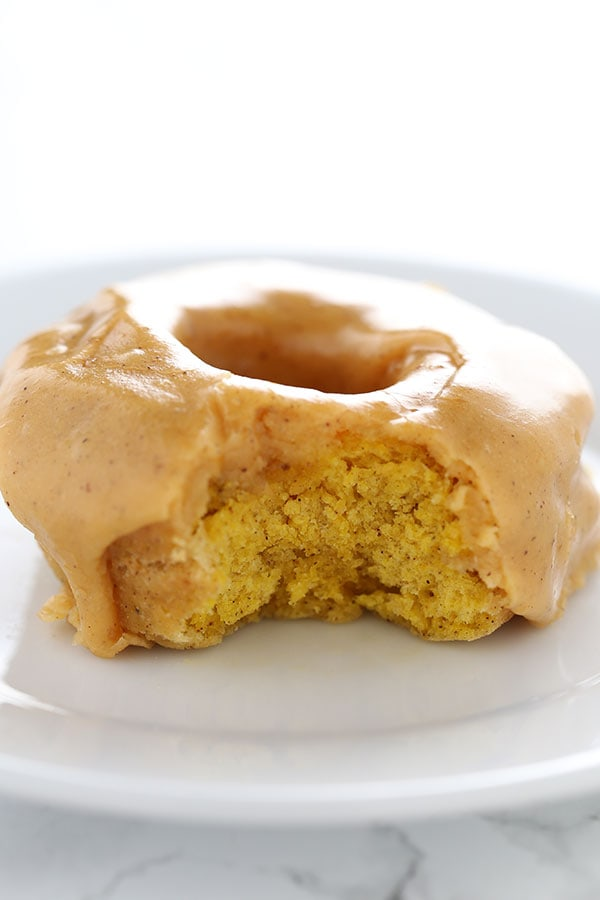 Pumpkin Old Fashioned Doughnuts are fried to perfection and loaded with pumpkin spice flavors and a thick shiny pumpkin glaze. No yeast makes this recipe quick and easy!