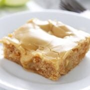 Salted Caramel Apple Sheet Cake features an ultra tender, slightly spongey cinnamon apple cake with a thick and shiny salted caramel glaze. Perfect for serving a crowd during the holidays!