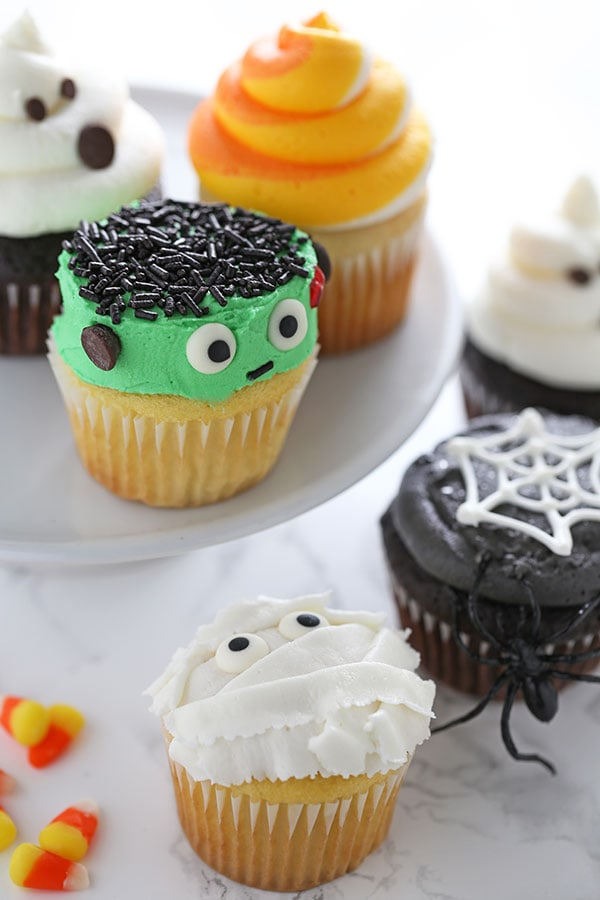 How to Make Halloween Cupcakes with 5 easy and fun decorating ideas! Save this pin for the step-by-step video, product list, tips,tricks, and more!