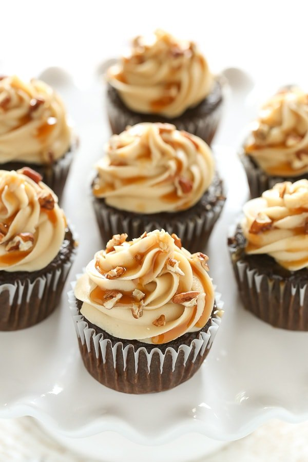 These Chocolate Turtle Cupcakes feature a soft and light chocolate cupcake, a rich caramel frosting, and are topped with caramel sauce and chopped pecans.