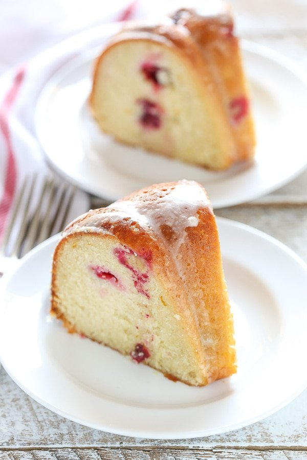 This Cranberry Orange Bundt cake features a soft and delicious cake with hints of orange and juicy cranberries in every bite!
