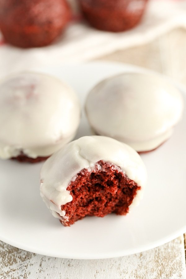 Baked Red Velvet Donut Holes topped with an easy cream cheese glaze and perfect for a sweet breakfast or Valentine's Day!