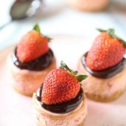 Chocolate Strawberry Mini Cheesecakes are perfectly easy, adorable, and transportable for the perfect Valentine's Day dessert. Plus they can be made ahead of time!