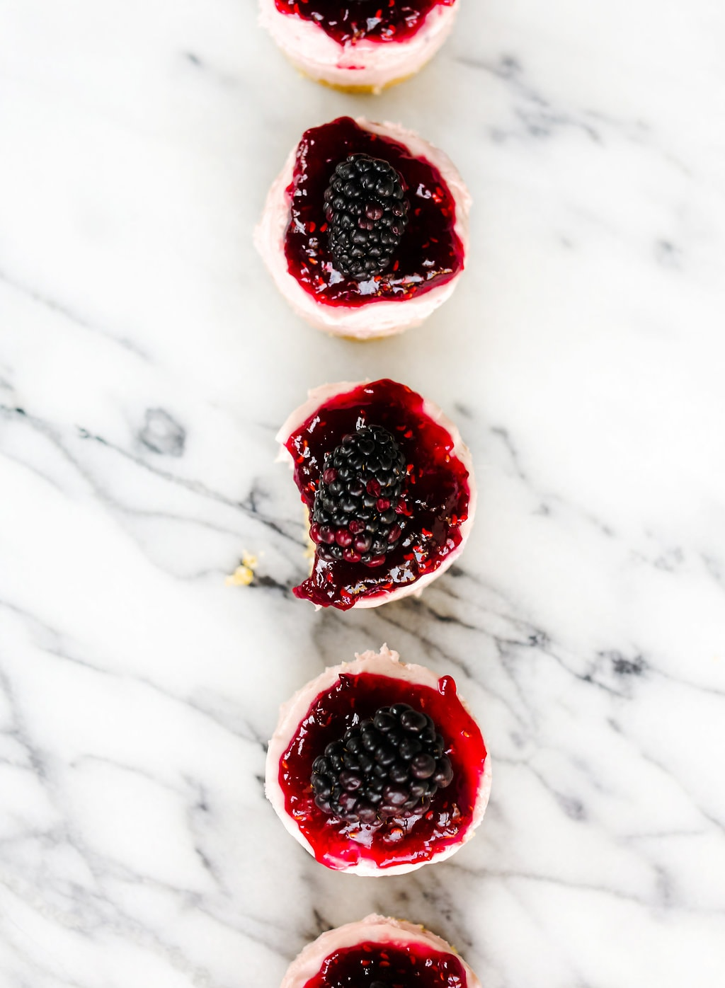 These NO BAKE mini blackberry cheesecakes are so cute and easy to transport! Perfect for a summer get together.
