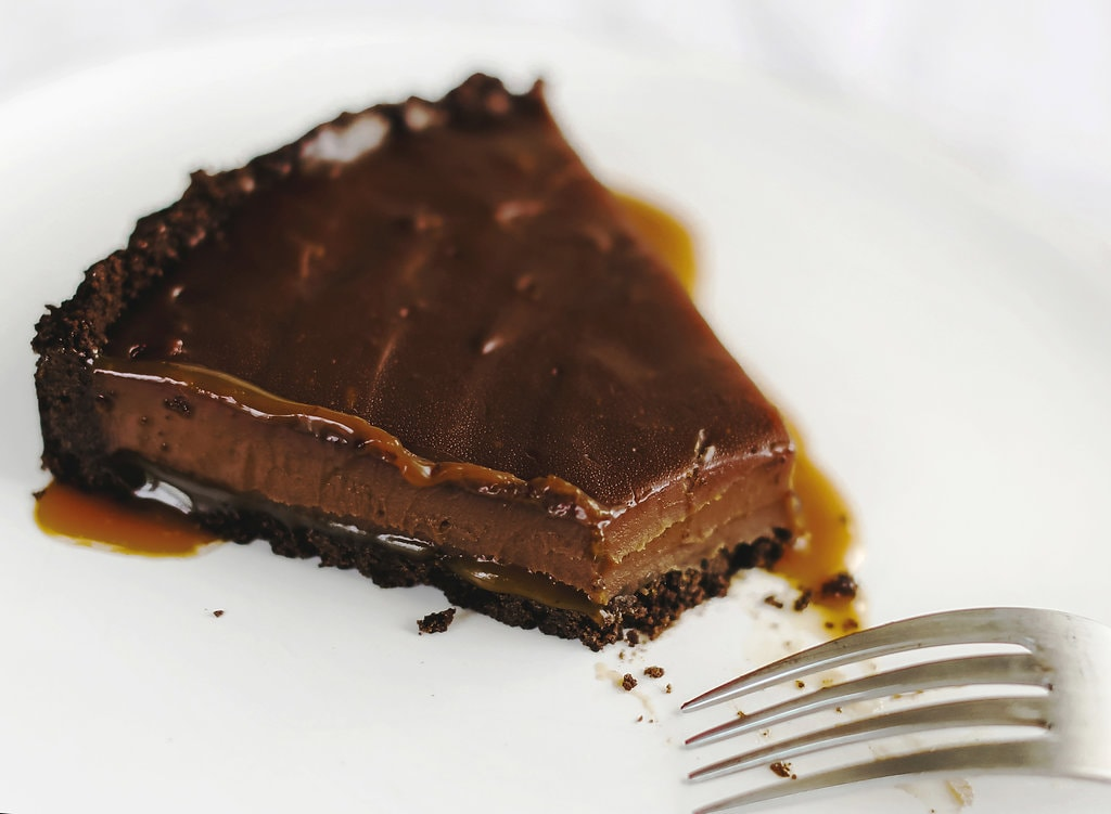 Slice of Nutella Salted Caramel Tart with bite taken out