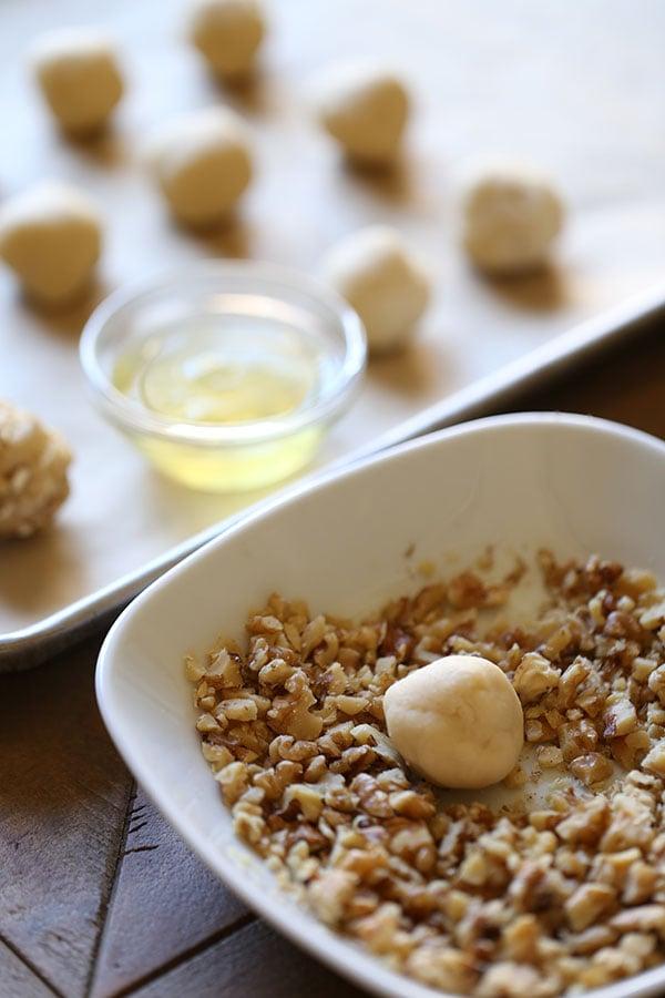 Making raspberry walnut thumbprint cookies