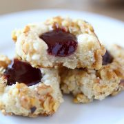 Easy Raspberry Walnut Thumbprint Cookies are buttery, crunchy, and crumbly with dollop of raspberry jam in the center of each!