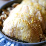 Honey Walnut Empanadas feature a buttery flaky crust filled with cream cheese, honey, and walnuts then topped with cinnamon sugar. Baked, not fried!