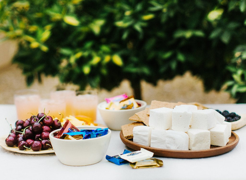 How to throw a fun, festive, but gourmet S'mores Bar Party complete with homemade s'mores and fun flavor ideas that'll impress everyone.