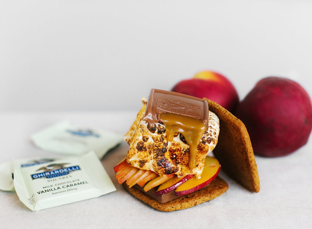 Peach S'mores made with homemade marshmallows and graham crackers! Topped with Ghirardelli caramel squares