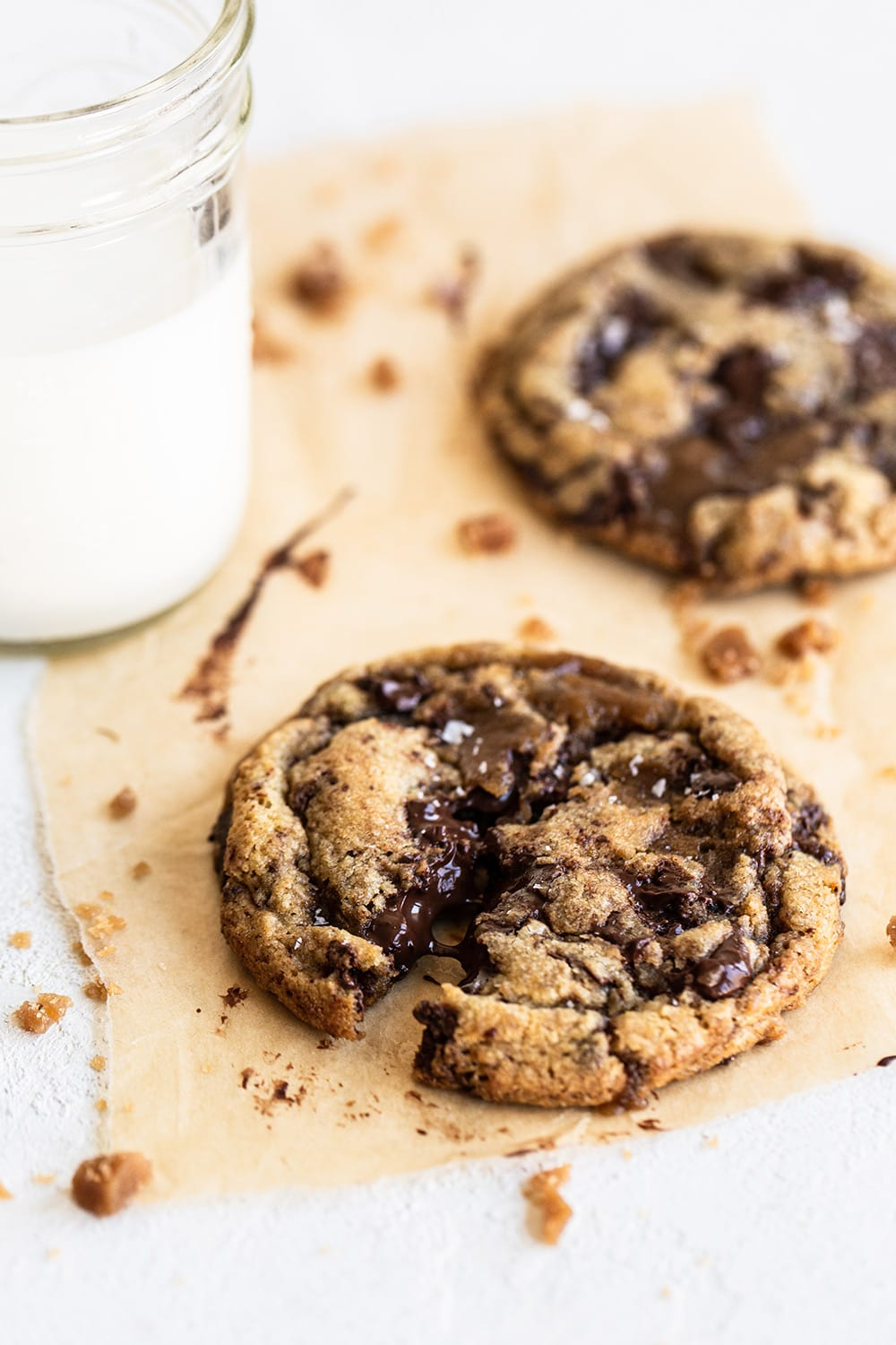 browned butter toffee chocolate chip cookies with glass of milk