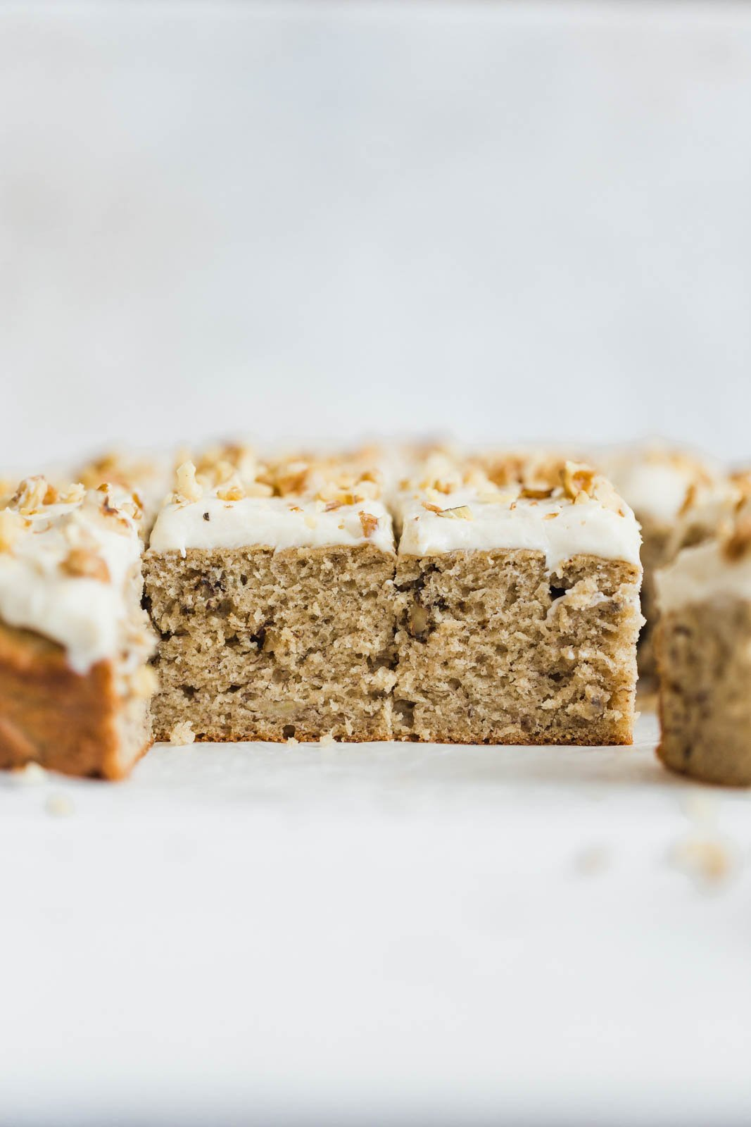 Banana Walnut Cake is a ridiculously easy one layer ultra moist banana cake loaded with flavor and topped with a rich cream cheese frosting.