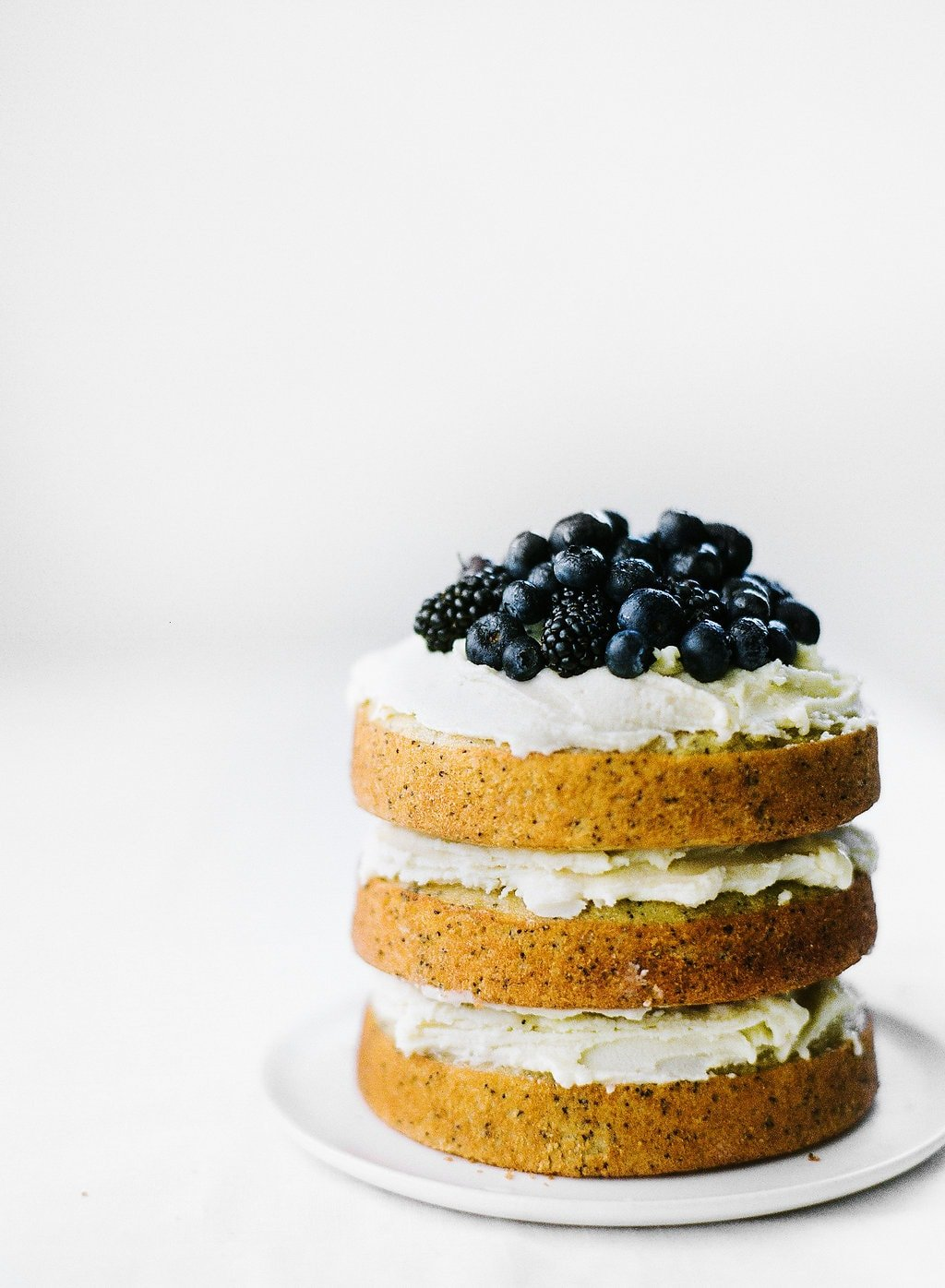 Vanilla Poppy Seed Cake with Whipped Ganache is three layers of ultra moist cake and pure vanilla decadence. No special decorating skills needed!