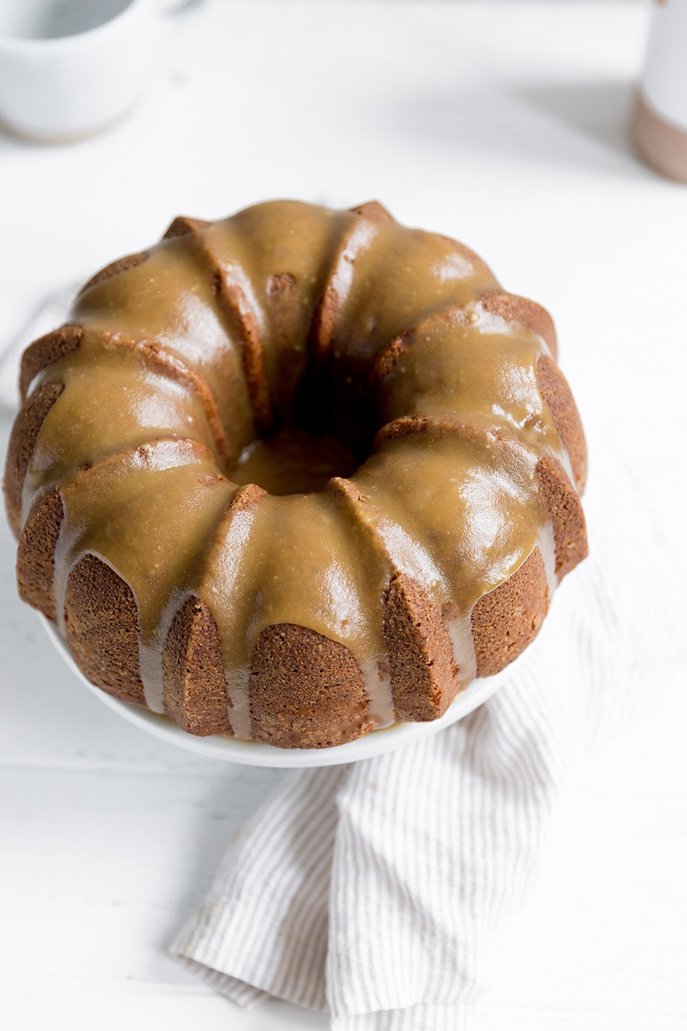 Butterscotch Bundt Cake features a brown sugar sour cream cake drizzled with a thick butterscotch icing for a simple and beautiful fall dessert.