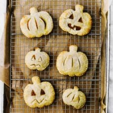 Adorable jack-o-lantern shaped Pumpkin Hand Pies are the perfect treat to celebrate the season. Made with the easiest pastry crust ever!