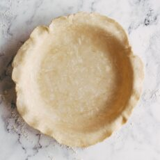 Pie dough rolled out and draped into pie dish