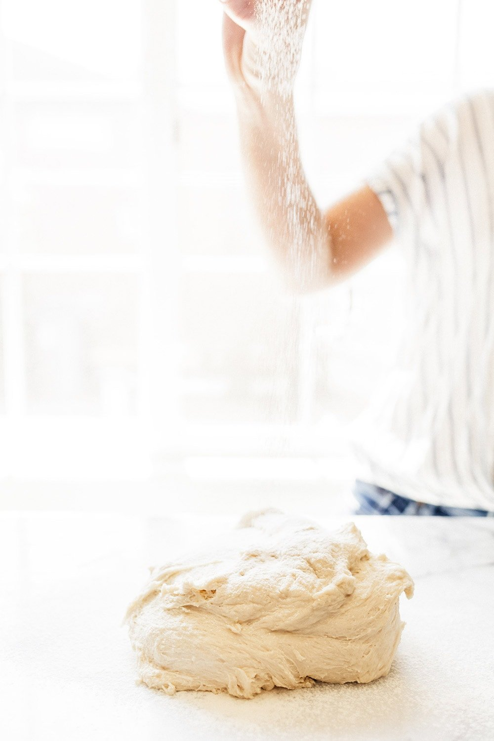 How to Knead Dough by hand without an electric mixer so you can create perfect bread rolls and loaves of bread. Kneading dough correctly is key!