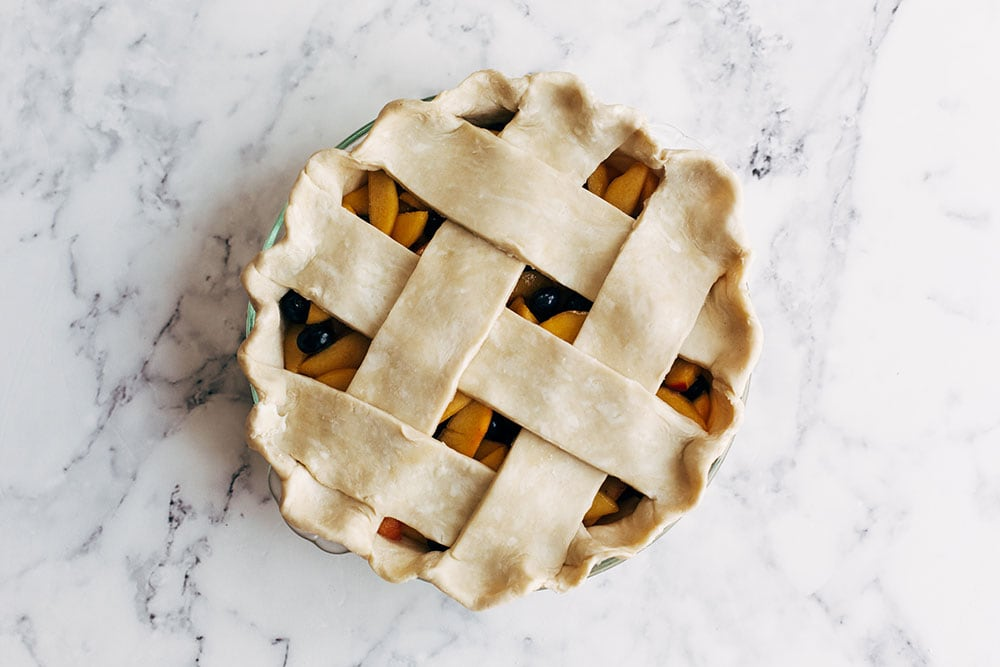 lattice fruit pie assembled and ready to bake