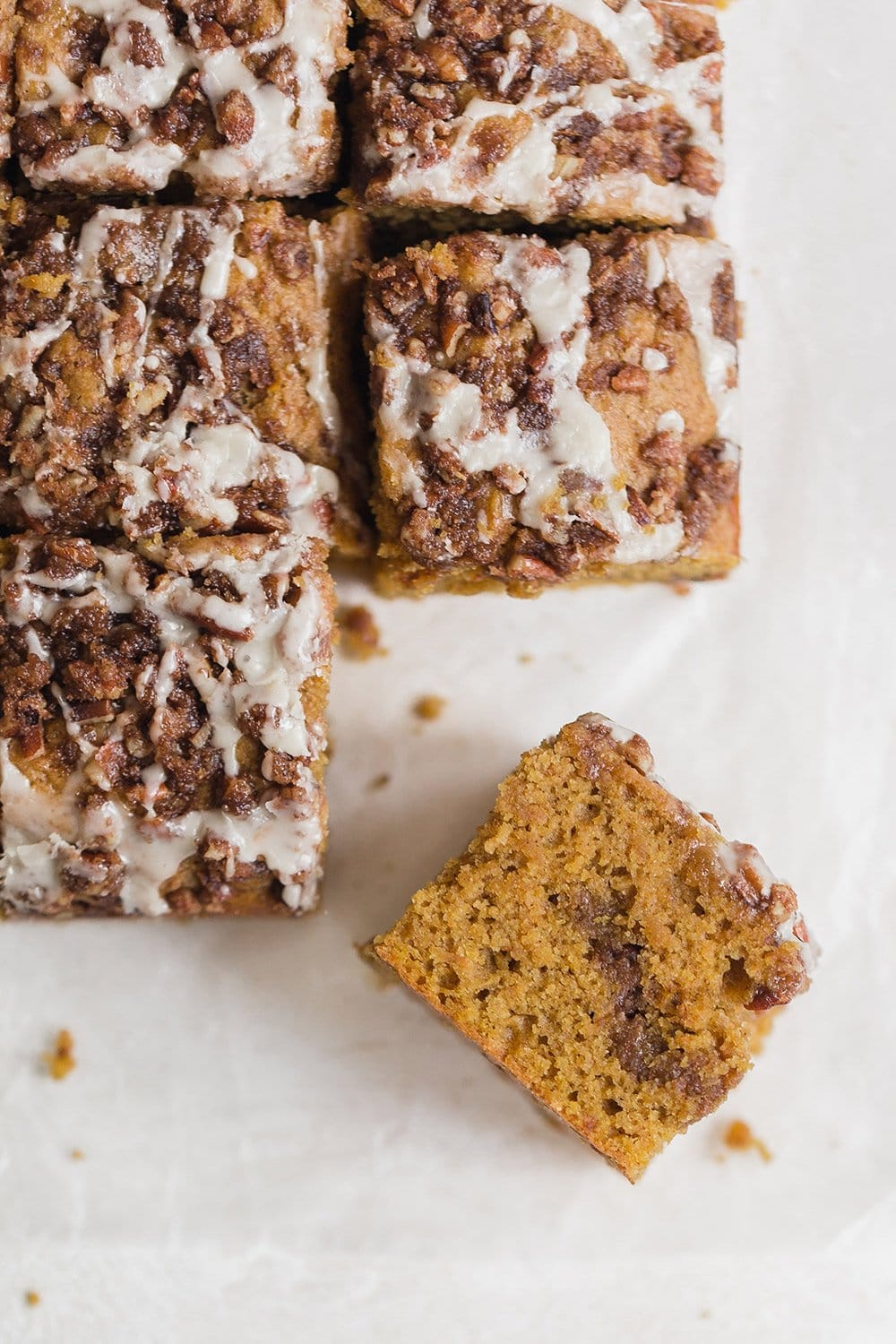 Homemade pumpkin spice coffee cake with pecan streusel and maple icing