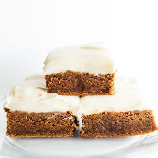 Gingerbread Cookie Bars with Cream Cheese Frosting are ultra thick, soft, and chewy with tons of aromatic spices and a generous layer of tangy frosting!