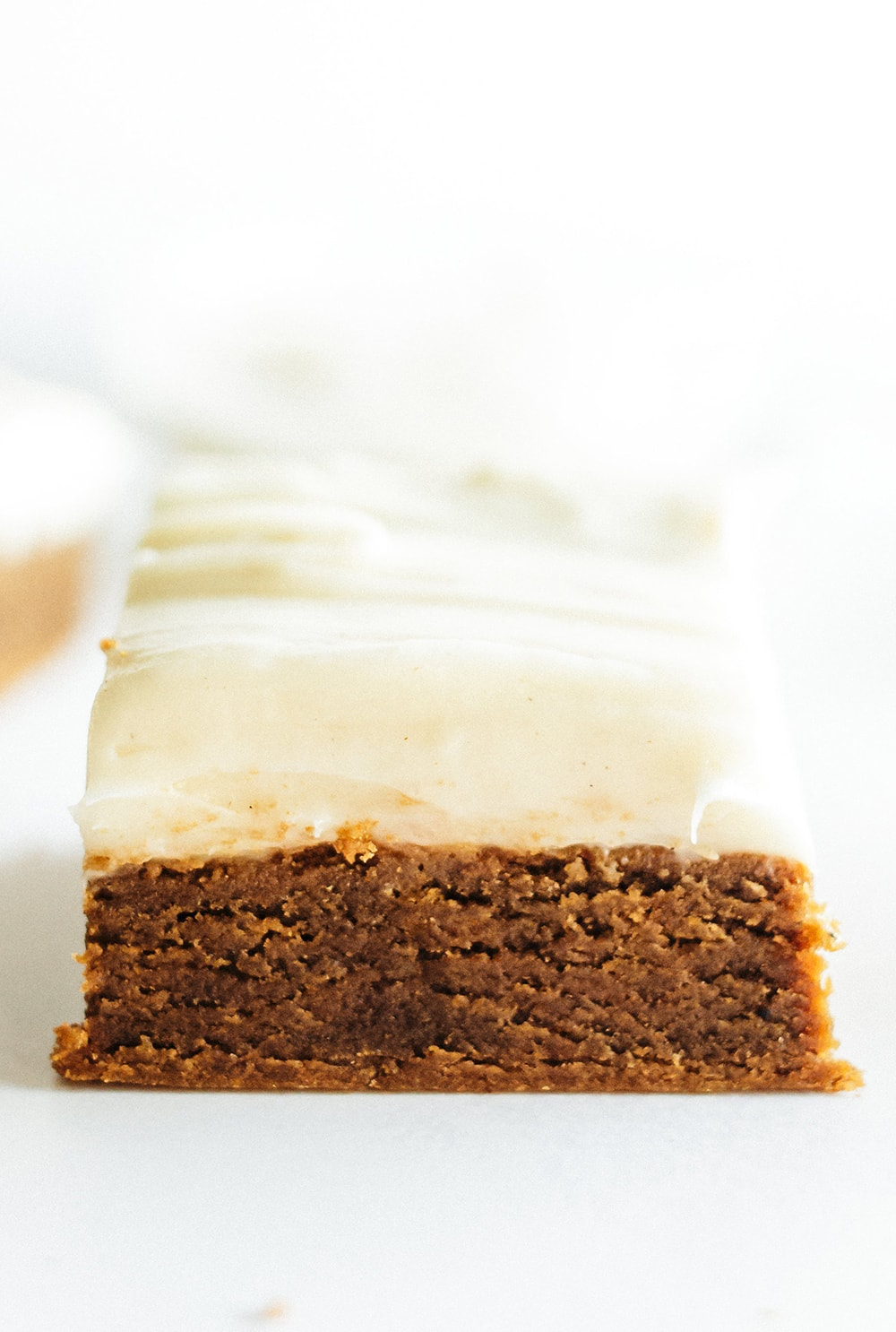 easy and soft gingerbread cookie bar with thick layer of cream cheese icing