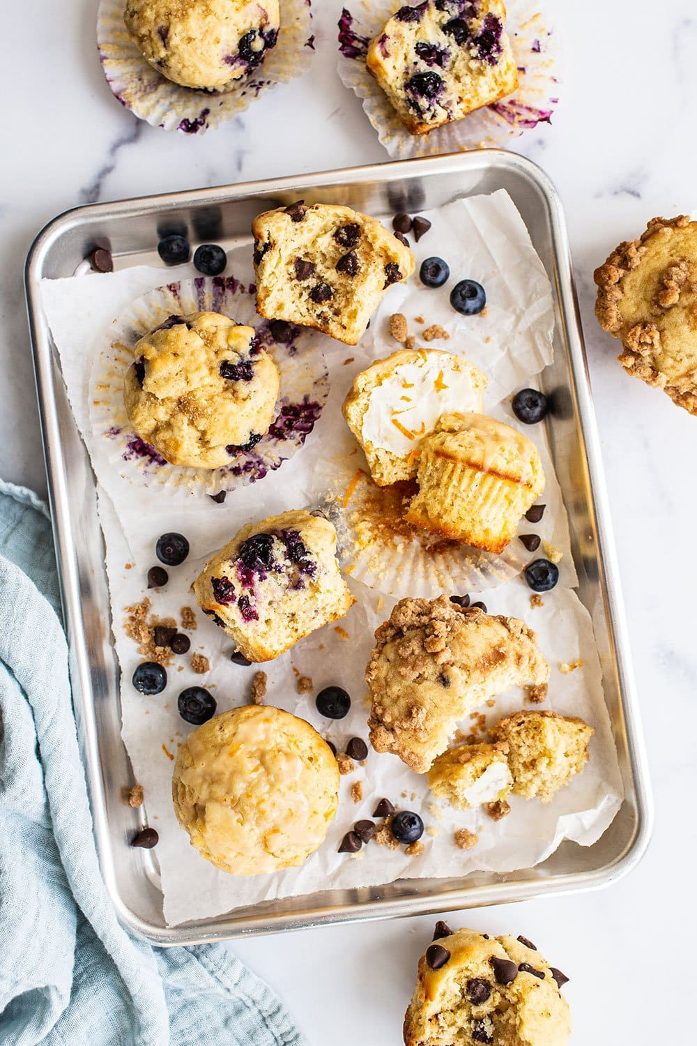 assortment of easy customizable ultimate muffins on a baking tray