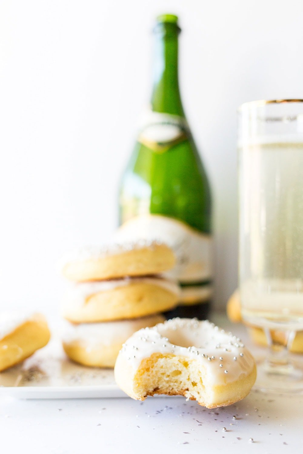 Baked Champagne Doughnuts are ultra light and fluffy. Made with champagne in the dough AND in the icing, these are perfect for any New Year's celebration.