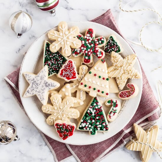 Easy Cut Out Sugar Cookies with Icing features a simple dough that's fun to work with so you can make any festive shaped and decorated cookies you want!