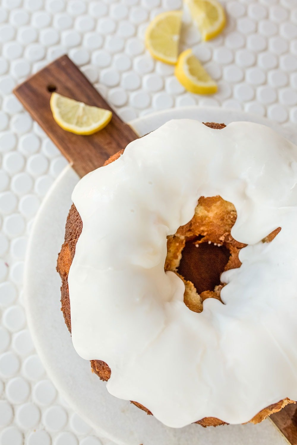 Fresh lemon bundt cake with lemon cake, sweet glaze, and a thick icing