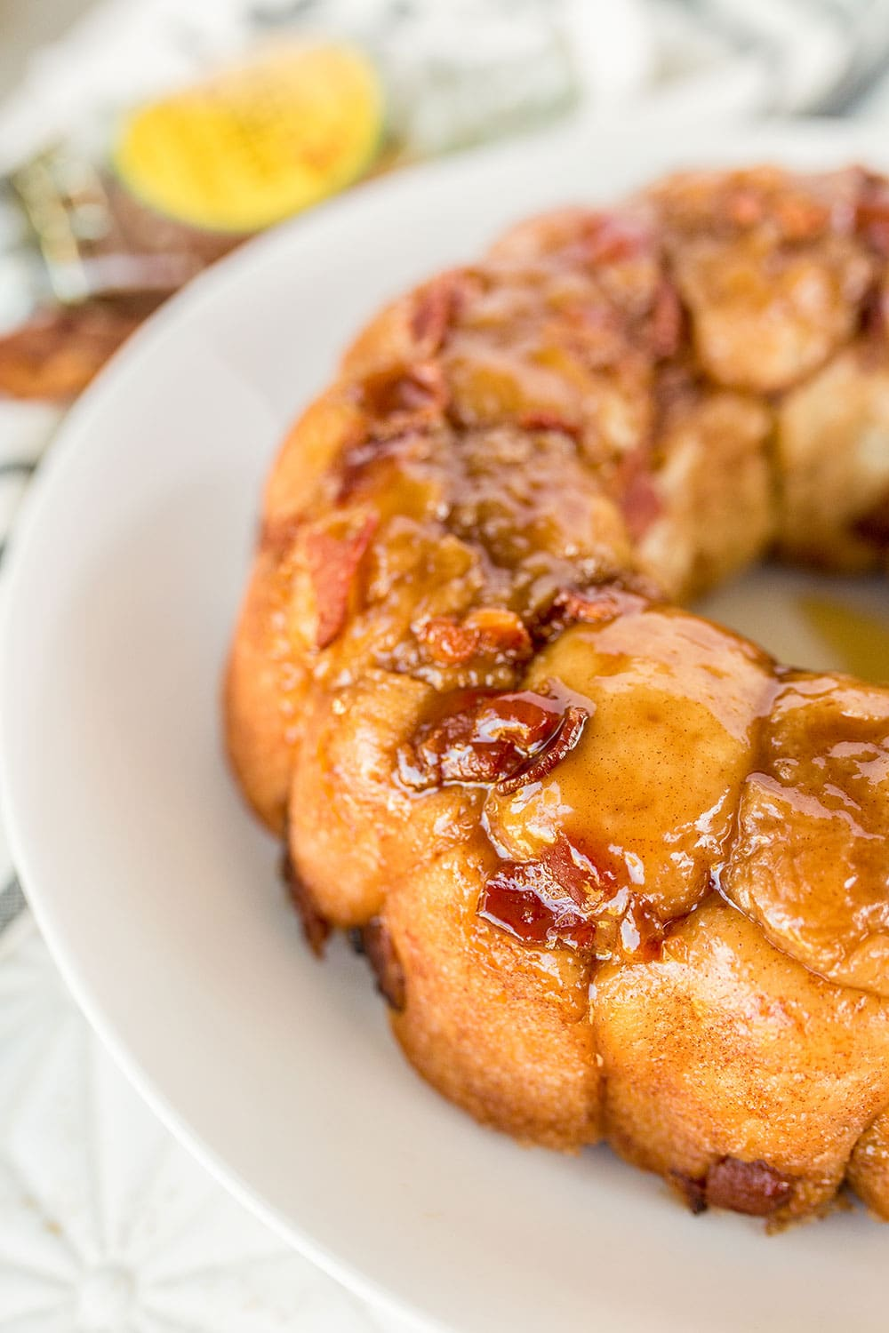 Insanely rich and gooey Maple Bacon Monkey Bread is loaded with sweet cinnamon, maple syrup, and tons of crisp bacon for the ultimate decadent treat.