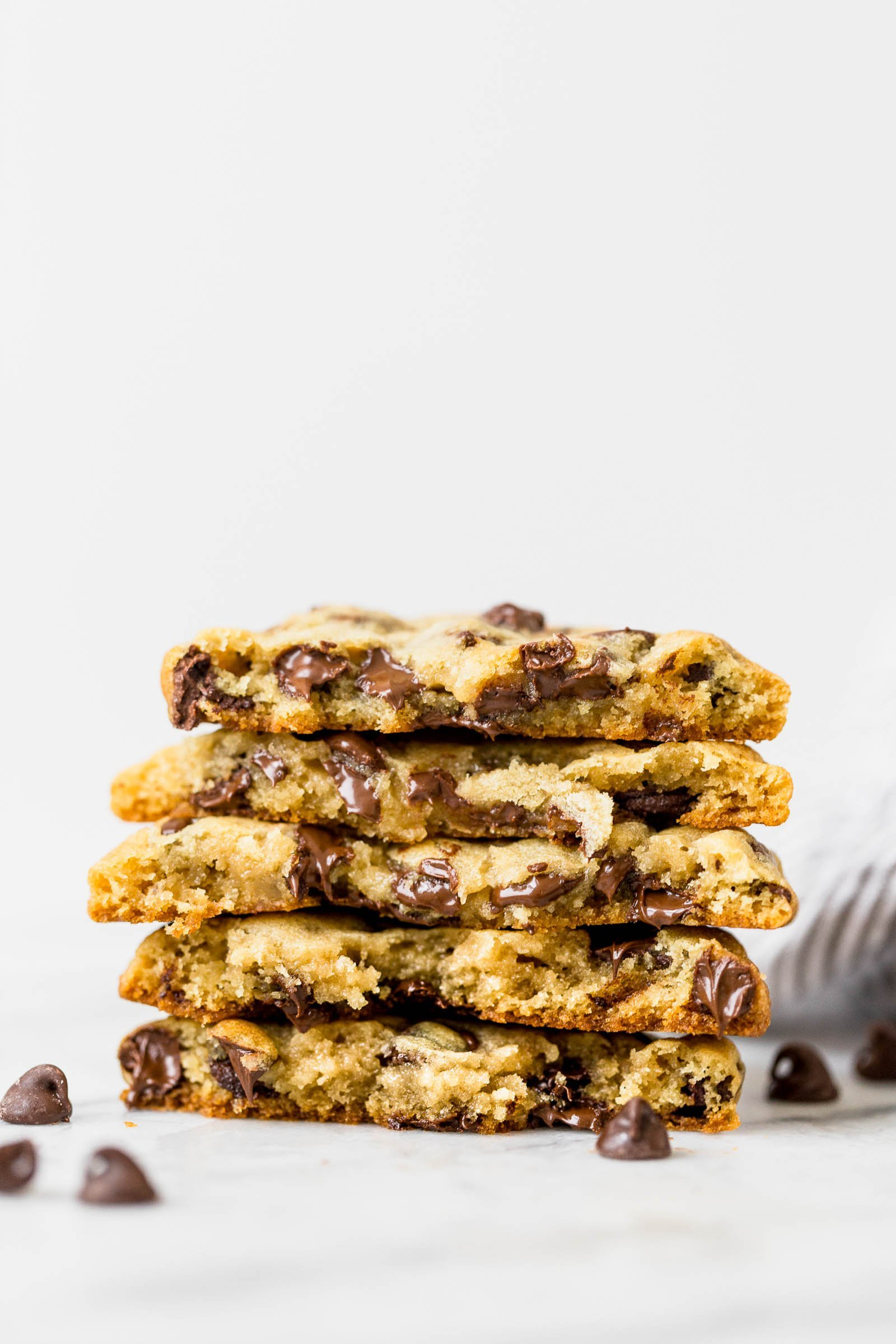 Best ooey gooey bakery style chocolate chip cookies stacked