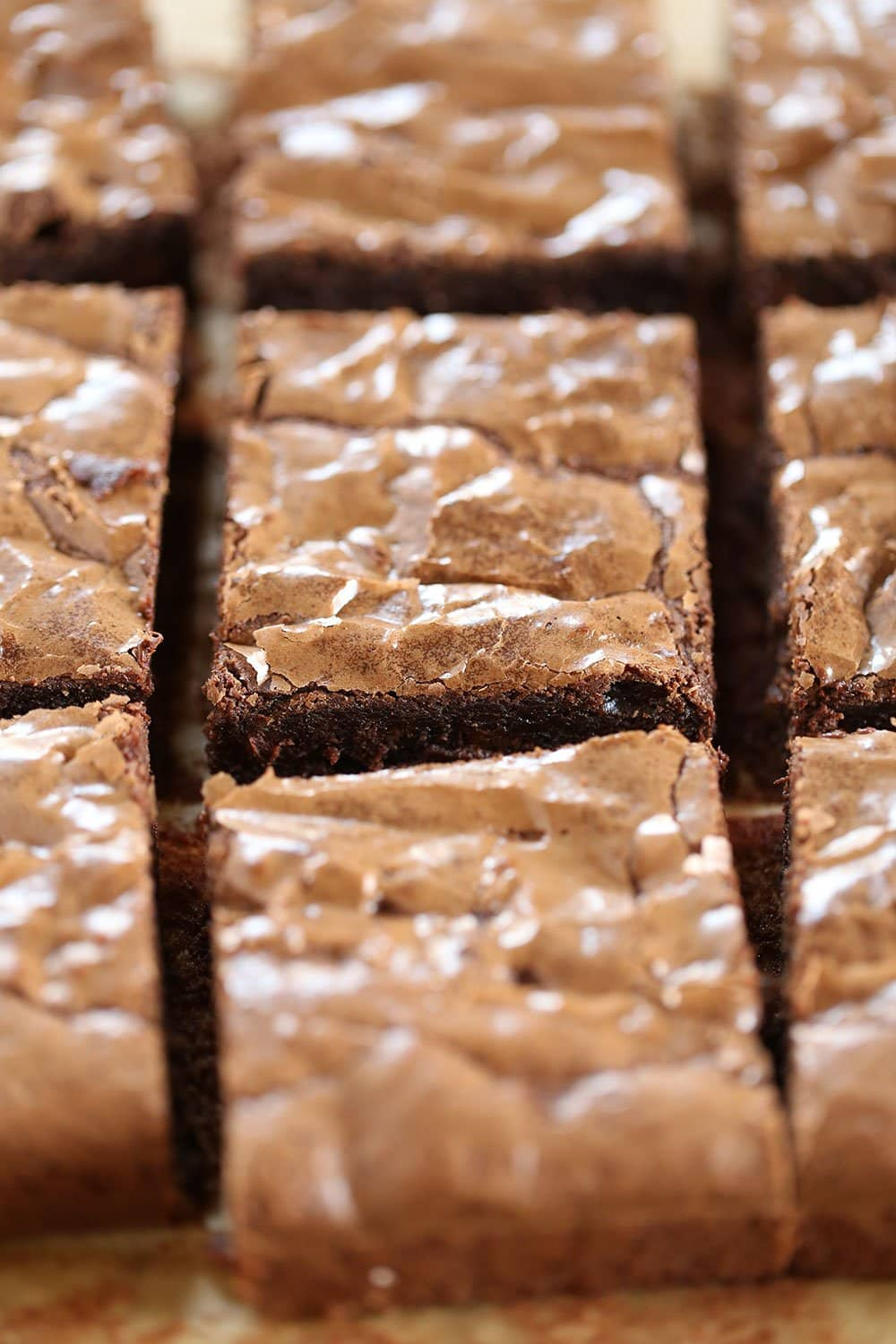 Best Easy Brownies require just 1 bowl, no mixer, and take less than an hour to make! They're tall, fudgy, and chewy with that thin shiny crust on top and tons of chocolate flavor.