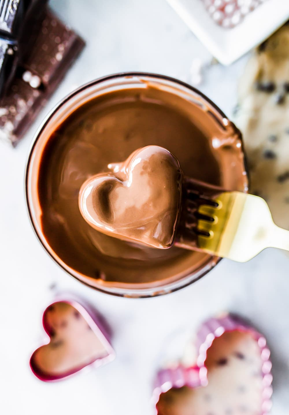 These adorable no-bake chocolate covered Cookie Dough Hearts are the perfect homemade chocolate treat for Valentine's Day, no chocolate tempering or candy melts required!