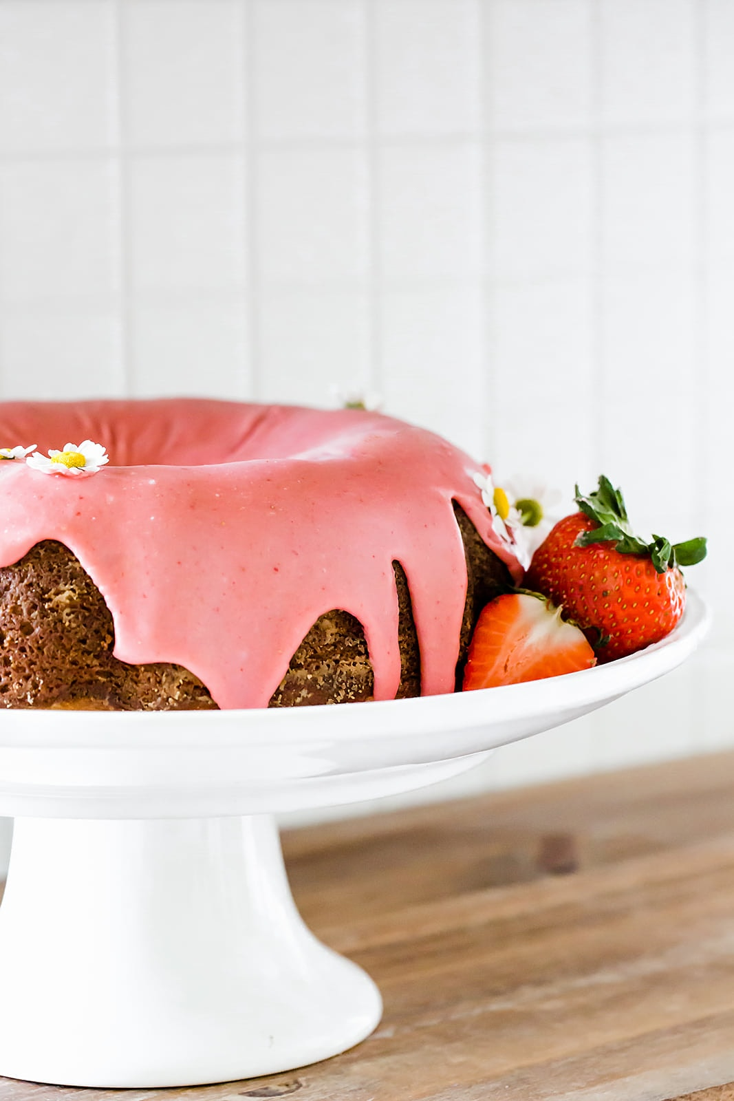 This light, fluffy, and flavorful Strawberry Bundt Cake is made with a fresh strawberry puree and absolutely no artificial colors or flavors! It's the perfect easy yet crowd-pleasing spring or summer cake.