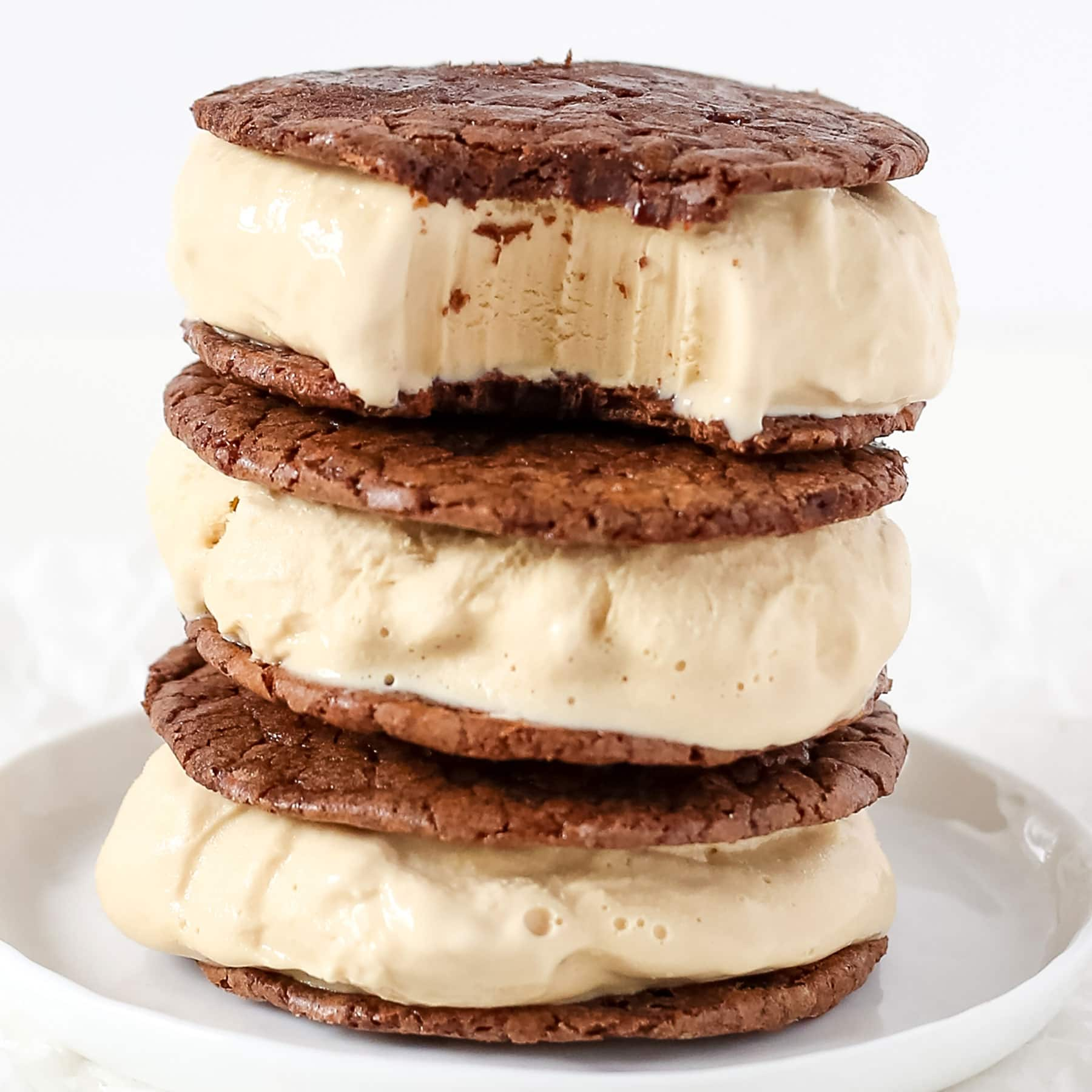 Coffee Brownie Ice Cream Sandwiches feature two layers of thin but ultra rich and fudgy brownie cookies sandwiching a generous layer of creamy cold brew coffee ice cream.