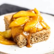Caramel Peach Snickerdoodle Bars feature a chewy cinnamon cookie bar layer loaded with a homemade gooey caramel peach topping.
