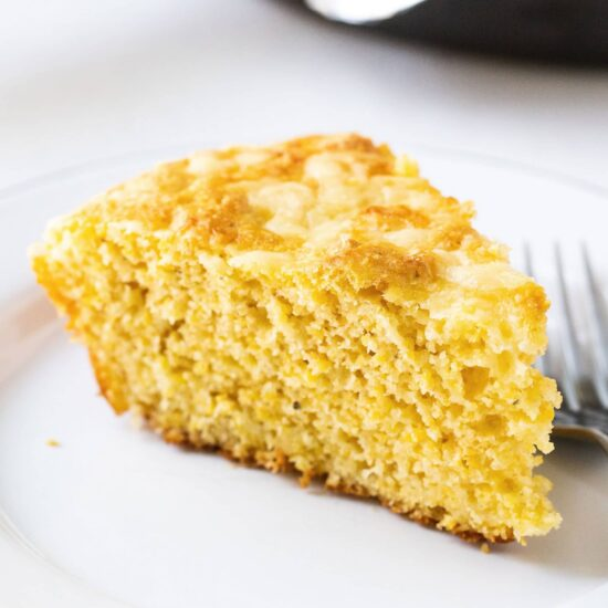 Cheesy Skillet Cornbread is ultra moist, tender, and loaded with cheddar cheese. It can be made in the oven or the grill, making it he perfect summer barbecue recipe!