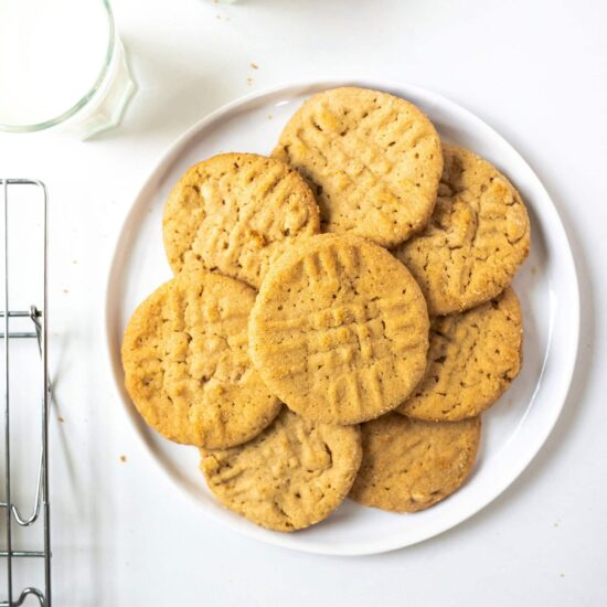 Classic Crunchy Peanut Butter Cookies are slightly soft in the center but loaded with roasted peanuts. They're a must for anyone's cookie repertoire and are perfectly easy and transportable for summer entertaining.