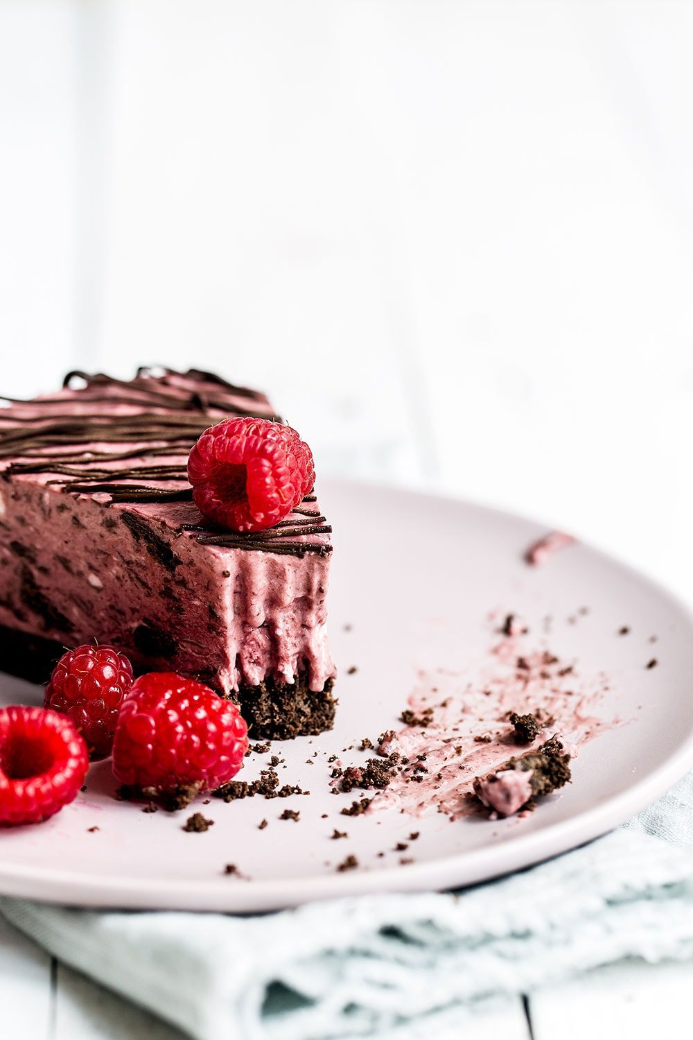 No Bake Frozen Chocolate Raspberry Pie features a chocolate graham cracker crust, creamy chocolate raspberry filling, and is topped with more chocolate! Perfect summer recipe that you can make ahead of time! No ice cream machine required.
