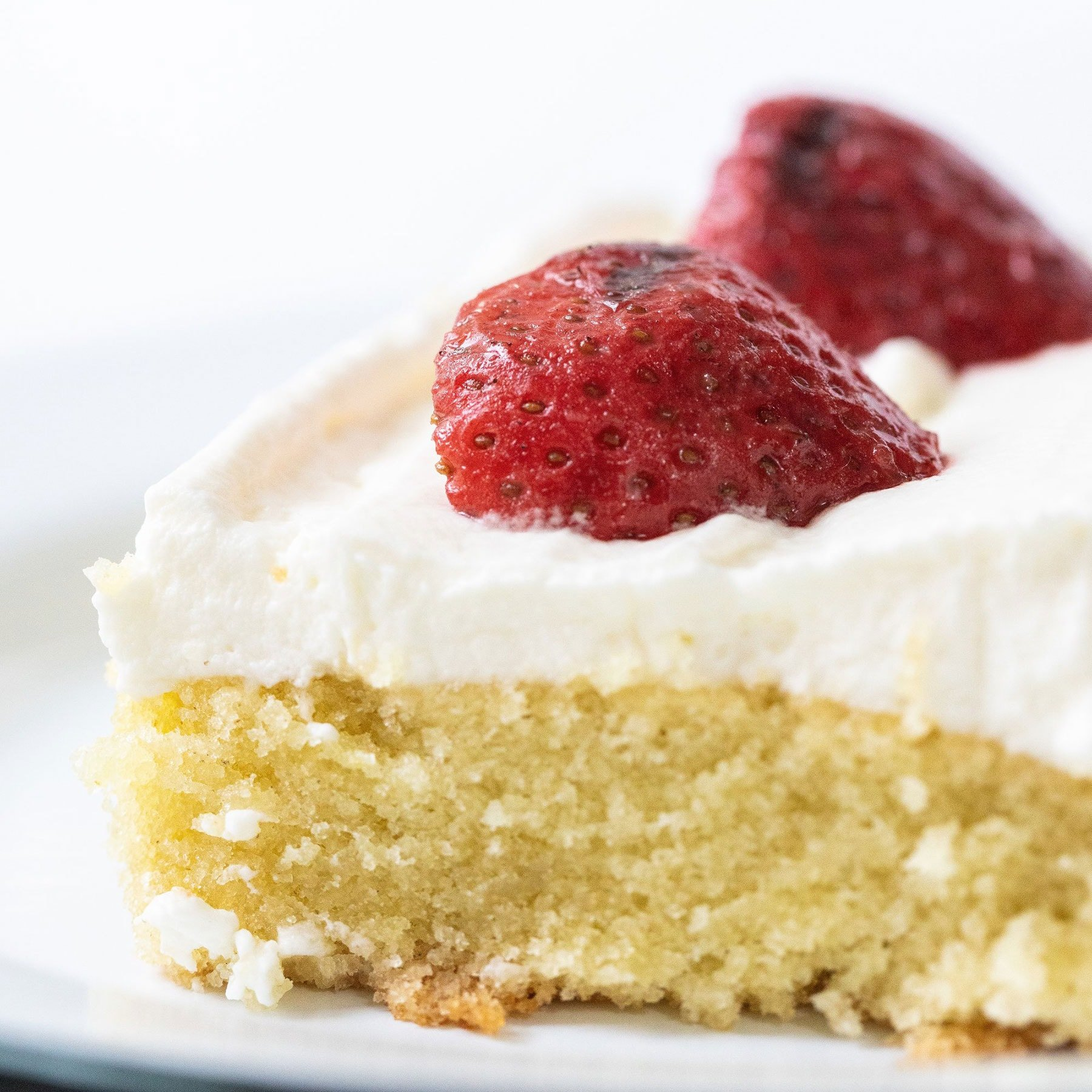 Vanilla Sheet Cake with Grilled Strawberries features an ultra moist, tender, and slightly spongy vanilla cake with fresh whipped cream and slightly smoky grilled strawberries on top. Perfect summer dessert for a crowd!