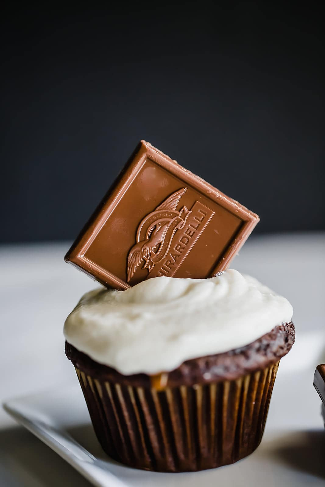Caramel Stuffed Chocolate Cupcakes feature a super moist and tender chocolate cupcake filled with luscious caramel sauce and topped with vanilla buttercream.
