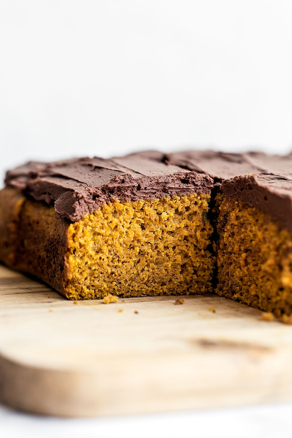 Easy Pumpkin Cake with Whipped Ganache features a super simple spiced pumpkin sour cream cake layer topped with creamy and light whipped chocolate ganache for a quick fall treat perfect for any party or craving!