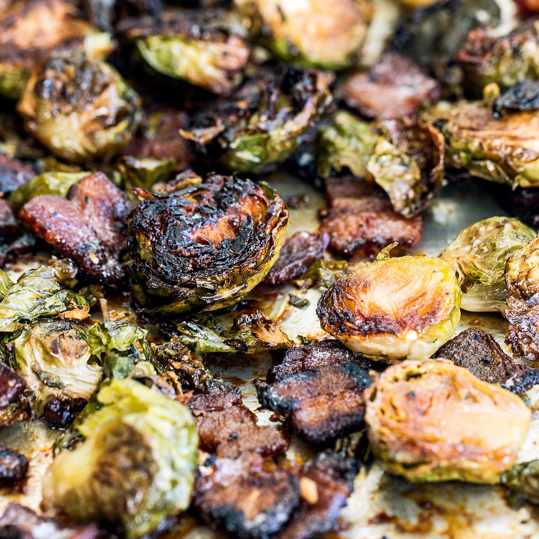 Maple Bacon Brussels Sprouts feature caramelized roasted Brussels sprouts with crispy bits of bacon and a touch of sweetness from the maple syrup. One pan three ingredient recipe!