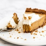 Butterscotch Pie is made with an easy spiced Biscoff cookie crust, homemade butterscotch pudding filling, and is topped with creamy whipped cream. Perfect fall treat!